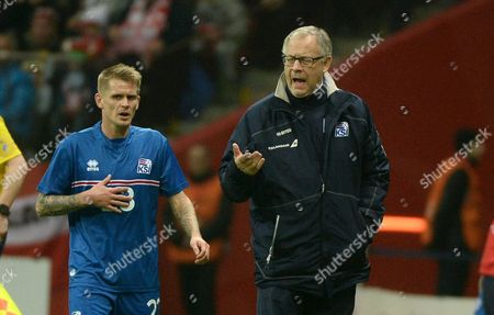 Icelandic National Soccer Team's Swedish Head Coach Lars Lagerback (r) and His Player Ari Freyr Skulason (l) During the International Friendly Soccer Match Between Poland and Iceland at the National Stadium in Warsaw Poland 13 November 2015 Poland Warsaw