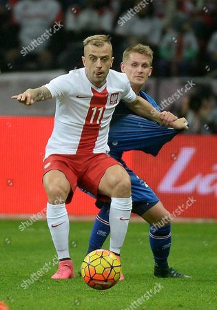 Poland's Kamil Grosicki (l) in Action Against Ari Freyr Skulason (r) of Iceland During the International Friendly Soccer Match Between Poland and Iceland at the National Stadium in Warsaw Poland 13 November 2015 Poland Warsaw