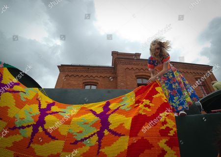 Stock Image of Polish-born Artist Agata 'Olek' Oleksiak Along with Helpers Makes a Crocheted 'Outfit' For a Locomotive Train in Lodz Poland 11 July 2013 the Crochet Creation Has to Be Ready on 13 July For the Opening of the 'Tuwim Station' As Part of the Tuwim Year Celebrations in the Country Julian Tuwim was a Polish Poet of Jewish Descent (1894-1953) Poland Lodz