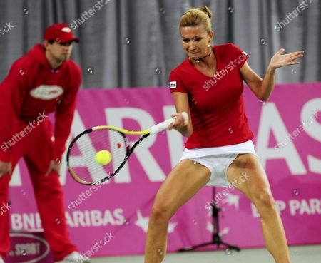 Poland's Marta Domachowska Returns the Ball to Belgian Yanina Wickmayer During the First-round World Group Ii Match of the Fed Cup in Bydgoszcz Poland 06 February 2010 Poland Bydgoszcz