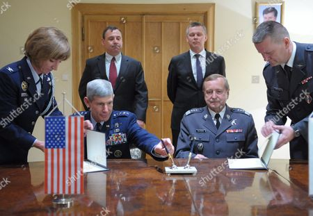 Us Air Force Chief of Staff General Norton Allan Schwartz (l Sitting) and His Polish Counterpart General Lech Majewski (r Sitting) Signed the 'Memorandum of Understanding Between the Department of Defense of the United States of America As Represented by the Us Air Force and the Minister of National Defence of the Republic of Poland Regarding the Exchange of Military Personnel' in Warsaw Poland 30 May 2012 the Memorandum was Signed in the Presence of the Polish Minister of Defence Tomasz Siemoniak (c) Poland Warsaw