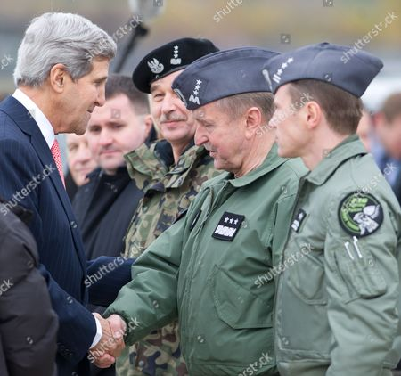 Us Secretary of State John Kerry (l) Shakes Hands with Commander of the Polish Air Force General Lech Majewski (2-r) Chief of General Staff of the Polish Army General Mieczyslaw Gocul (3-r) and Commander of the 32nd Tactical Air Base Col Pil Krystian Ziec (r) During His Visit to the 32 Tactical Air Base in Lask Poland 05 November 2013 Us Secretary Kerry Continued His Official Visit to Poland Poland Warsaw