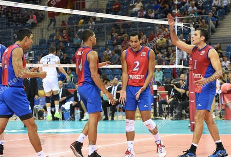 Hector Soto (l) Mannix Roman (2-l) Edgardo Goas (2-r) and Jose Rivera (r) of Puerto Rico Celebrate a Point During the Match Between Puerto Rico and France in Group D the Fivb Volleyball Men's World Championship Poland 2014 at the Arena Krakow in Cracow Poland 31 August 2014 the Championship Will Be Held in Poland From 30 August to 21 September Poland Cracow