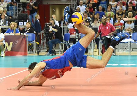 Jose Rivera of Puerto Rico in Action During the Match Between Puerto Rico and France in Group D the Fivb Volleyball Men's World Championship Poland 2014 at the Arena Krakow in Cracow Poland 31 August 2014 the Championship Will Be Held in Poland From 30 August to 21 September Poland Cracow