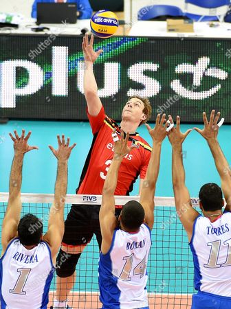 Sam Deroo (back) of Belgium in Action Against Puerto Rican Players Jose Rivera (l) Mannix Roman (c) and Maurice Torres (r) During the Fivb Volleyball Men's World Championship Group D Match Between Belgium and Puerto Rico at the Arena Krakow in Cracow Poland 02 September 2014 Poland Cracow