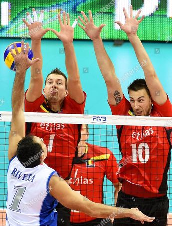 Belgian Players Bram Van Den Dries (c) and Simon Van De Voorde (r) in Action Against Jose Rivera (l) of Puerto Rico During the Fivb Volleyball Men's World Championship Group D Match Between Belgium and Puerto Rico at the Arena Krakow in Cracow Poland 02 September 2014 Poland Cracow