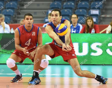 Dennis Del Valle (l) and Jose Rivera (r) of Puerto Rico in Action During the Group D Match Between Puerto Rico and Italy For the Fivb Volleyball Men's World Championship Poland 2014 at the Arena Krakow in Cracow Poland 06 September 2014 Poland Cracow