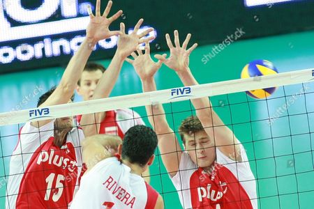 Puerto Rico's Jose Rivera in Action Against Poland's Lukasz Zygadlo (l) and Piotr Nowakowski (r) During Their Volleyball World League Match at Orlen Arena Hall in Plock Poland 25 June 2011 Poland Plock