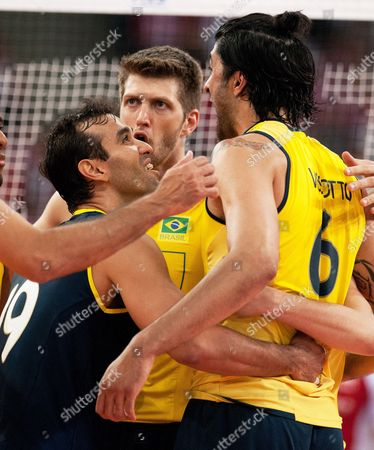Brazilian Players (l-r) Mario Da Silva Pereira Jr Eder Carbonera and Leandro Vissotto Celebrate a Point During the Fivb Men's Volleyball World League Match Between Poland and Brazil in Lodz Poland 09 June 2013 Poland Lodz
