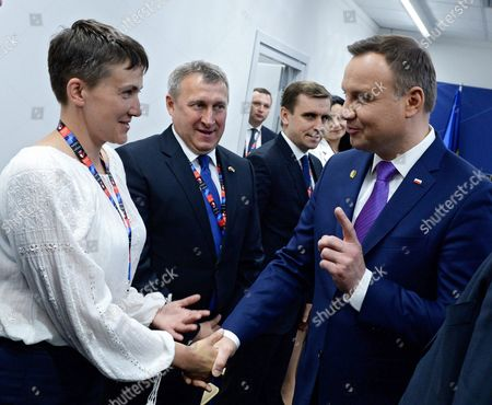 Stock Photo of Ukrainian Politician and Former Pilot Nadezhda Savchenko (l-r) Ukrainian Ambassador to Poland Andrii Deshchytsia Deputy Head of the Presidential Administration of Ukraine Konstantin Yeliseyev and Polish President Andrzej Duda Talk Before a Bilateral Meeting During the Second Day of the Nato Summit in Warsaw Poland 09 July 2016 the Nato Warsaw Summit Takes Place on 08 and 09 July with About 2 000 Delegates Including 18 State Heads 21 Prime Ministers 41 Foreign Ministers and 39 Defence Ministers Taking Part in the Summit Poland Warsaw