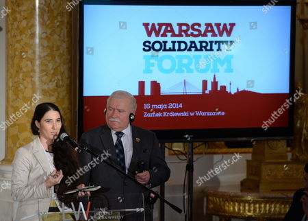 Former President of Poland and Nobel Peace Prize Laureate Lech Walesa (r) Listens to Cuban Dissident Blogger Yoani Sanchez (l) During 'Changes in Practice: Tools and Challenges' Debate at the Warsaw Solidarity Forum at the Royal Castle in Warsaw Poland 16 May 2014 the Forum 25 Years After the Historic Transition That Brought Freedom to Poland and 10 Years After Poland Joined the Eu is Focused on the Lesson That Can Be Drawn From the Polish Transformation For the Region and the World Poland Warsaw