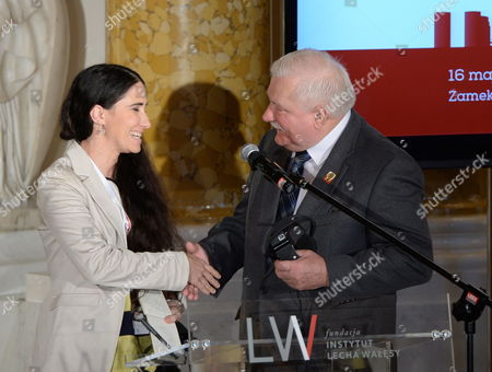 Former President of Poland and Nobel Peace Prize Laureate Lech Walesa (r) Welcomes Cuban Dissident Blogger Yoani Sanchez (l) During 'Changes in Practice: Tools and Challenges' Debate at the Warsaw Solidarity Forum at the Royal Castle in Warsaw Poland 16 May 2014 the Forum 25 Years After the Historic Transition That Brought Freedom to Poland and 10 Years After Poland Joined the Eu is Focused on the Lesson That Can Be Drawn From the Polish Transformation For the Region and the World Poland Warsaw