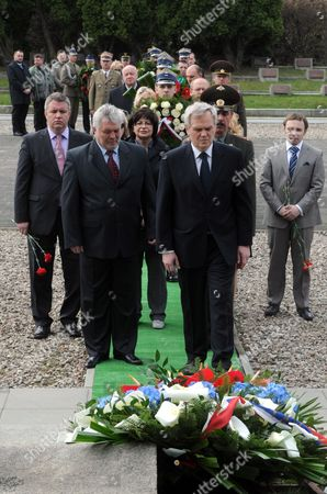 Russian Ambassador to Poland Alexander Alekseev (centre Right) Lays Wreath During the Burial Ceremony of the Remains of 29 Soviet Army Soldiers who Died in the Tank Battle of Radzymin in 1944 in the Cemetery Mausoleum of Soldiers of Russian Army in Warsaw Poland 24 April 2013 the Remains Were Found in a Forest on the Outskirts of the Village Krubki - Gorki and Exhumed in December 2012 Poland Warsaw