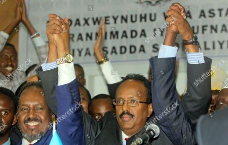 Mohamed Abdullahi Farmajo, Hassan Sheikh Mohamud New Somali President Mohamed Abdullahi Farmajo, center, joins hands with incumbent President Hassan Sheikh Mohamud, left, as he celebrates winning the election and taking office in Mogadishu, Somalia . Former prime minister Farmajo who holds dual Somali-U.S. citizenship was declared Somalia's new president Wednesday, immediately taking the oath of office as the long-chaotic country moved toward its first fully functioning central government in a quarter-century
