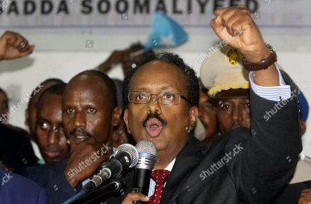 New Somali President Mohamed Abdullahi Farmajo celebrates winning the election and taking office in Mogadishu, Somalia . Former prime minister Farmajo who holds dual Somali-U.S. citizenship was declared Somalia's new president Wednesday, immediately taking the oath of office as the long-chaotic country moved toward its first fully functioning central government in a quarter-century