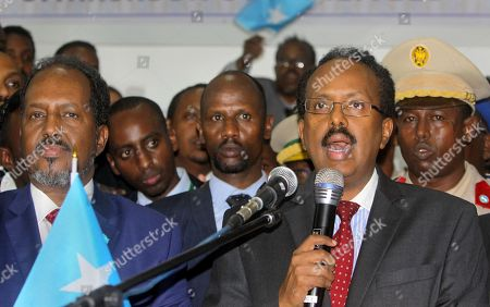 Mohamed Abdullahi Farmajo, Hassan Sheikh Mohamud New Somali President Mohamed Abdullahi Farmajo, right, is joined by incumbent President Hassan Sheikh Mohamud, left, as he speaks to reporters after winning the election in Mogadishu, Somalia . Former prime minister Farmajo who holds dual Somali-U.S. citizenship was declared Somalia's new president Wednesday, immediately taking the oath of office as the long-chaotic country moved toward its first fully functioning central government in a quarter-century