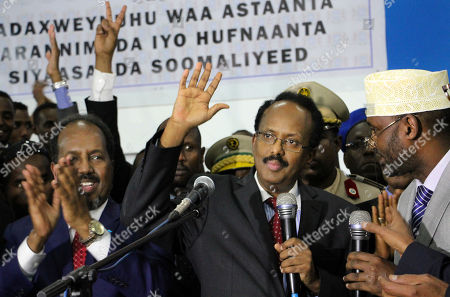 Mohamed Abdullahi Farmajo, Hassan Sheikh Mohamud New Somali President Mohamed Abdullahi Farmajo, second right, waves to supporters as he is joined by incumbent President Hassan Sheikh Mohamud, left, after winning the election in Mogadishu, Somalia . Former prime minister Farmajo who holds dual Somali-U.S. citizenship was declared Somalia's new president Wednesday, immediately taking the oath of office as the long-chaotic country moved toward its first fully functioning central government in a quarter-century