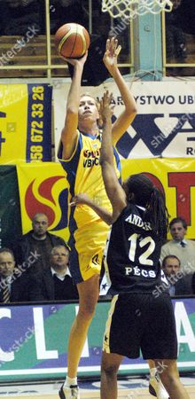 Stock Picture of Lotos Vbw Clima Gdynia 'S Malgorzata Dydek (l) Tries to Score Against Miz-o Pesci Pecs' Chantelle Anderson (r) During Their Euroleague Group B Basketball Match in Gdynia Poland on Thursday 18 December 2003 Lotos Won 70-63 Poland Gdynia