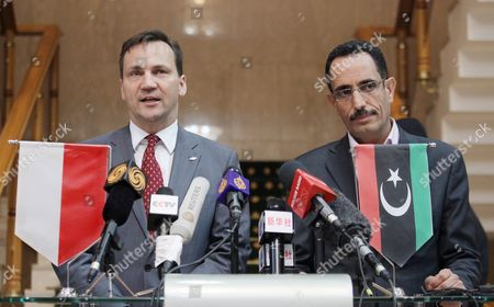 Polish Foreign Minister Radoslaw Sikorski (l) and Abdul Hafiz Ghoga (r) the Libyan Interim Transitional National Council Spokesman During a Press Conference in Benghazi Libya 11 May 2011 Sikorski is to Meet Insurgents' Leaders He is the First Foreign Minister of a Western State to Meet with the Insurgents the Trip Has Been Agreed Upon with Eu's Catherine Ashton and with Nato Countries Libyan Arab Jamahiriya Benghazi