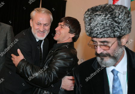 The Head of the Chechen Government in Exile Ahmed Zakayev (l) Welcomed by Supporters and Compatriots After Arriving in Pultusk Poland 17 September 2010 a Polish Court Ordered Exiled Chechen Leader Akhmed Zakayev Be Freed Late on 17 September While Russia's Demand For His Extradition is Decided the Warsaw District Court Rejected a Request by Prosecutors to Place Zakayev Under Temporary Arrest For 40 Days He Had Been Arrested Earlier on 17 September by Polish Police on an International Warrant Issued by Russia Through Interpol Zakayev Arrived on 16 September in Poland to Attend a Two-day World Chechen Congress in Pultusk in Central Poland Poland Pultusk
