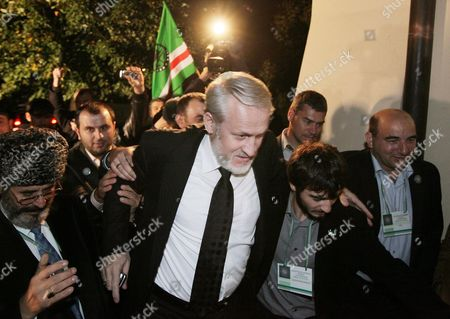 Stock Picture of The Head of the Chechen Government in Exile Ahmed Zakayev (c) Welcomed by His Countrymen After Arriving in Pultusk Poland 17 September 2010 a Polish Court Ordered Exiled Chechen Leader Akhmed Zakayev Freed Late on 17 September While Russia's Demand For His Extradition is Decided the Warsaw District Court Rejected a Request by Prosecutors to Place Zakayev Under Temporary Arrest For 40 Days He Had Been Arrested Earlier on 17 September by Polish Police on an International Warrant Issued by Russia Through Interpol Zakayev Arrived on 16 September in Poland to Attend a Two-day World Chechen Congress in Pultusk in Central Poland Poland Pultusk