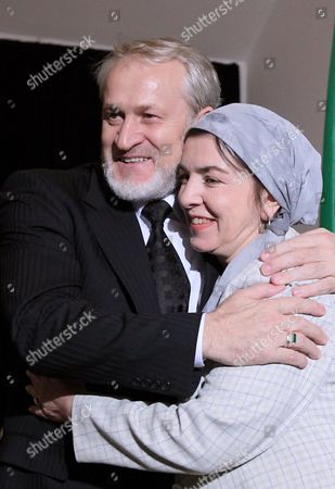 Stock Image of The Head of the Chechen Government in Exile Ahmed Zakayev (l) and Aminat Saieva (r) the Representative of Chechen Republic Ichkeria Government in Baltic Countries After of the World Congress of the Chechen Nation in Pultusk North of Warsaw on 18 September 2010 a Polish Court Ordered Exiled Chechen Leader Akhmed Zakayev Freed Late on 17 September While Russia's Demand For His Extradition is Decided the Warsaw District Court Rejected a Request by Prosecutors to Place Zakayev Under Temporary Arrest For 40 Days He Had Been Arrested Earlier on 17 September by Polish Police on an International Warrant Issued by Russia Through Interpol Zakayev Arrived on 16 September in Poland to Attend a Two-day World Chechen Congress in Pultusk in Central Poland Poland Pultusk