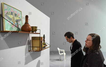 Visitors Look at Hanging Shelves with Items on Display As Part of the 'Unsubscribe' Exhibition by German Contemporary Artist Gregor Schneider at the Zacheta National Gallery of Art in Warsaw Poland 28 November 2014 the Exhibition Shows Contents and Fragments of the Demolished Family House of the Third Reich Propaganda Minister Joseph Goebbels Schneider's Ambition is to Destroy the Different Fragments of the House Although Treating the Building As a Silent Witness to History the Exhibition Runs From 29 November to 01 February 2015 Poland Warsaw
