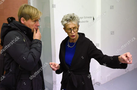 German Contemporary Artist Gregor Schneider (l) Talks with Exhibition Curator Anda Rottenberg (r) at the Zacheta National Gallery of Art where His Exhibition 'Unsubscribe' Takes Place in Warsaw Poland 28 November 2014 the Exhibition Shows Contents and Fragments of the Demolished Family House of the Third Reich Propaganda Minister Joseph Goebbels Schneider's Ambition is to Destroy the Different Fragments of the House Although Treating the Building As a Silent Witness to History the Exhibition Runs From 29 November to 01 February 2015 Poland Warsaw