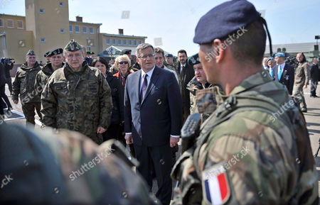 President of Poland Bronislaw Komorowski (c) with Polish General Commander of the Armed Forces Types General Lech Majewski (l) Review the Troops of French Soldiers During His Visit to the Drawsko Pomorskie Military Training Ground in Drawsko Pomorskie Northern Poland 30 April 2015 Polish Us Canadian and French Soldiers Train Together As Part of the Heavy Detachment French Detachment and Maple Detachment Poland Drawsko Pomorskie