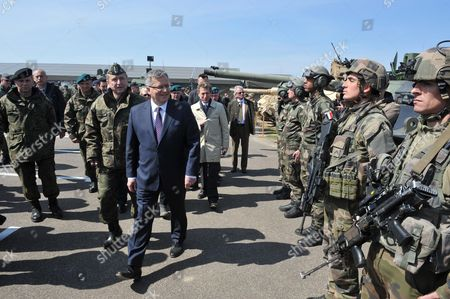 President of Poland Bronislaw Komorowski (c) with Polish General Commander of the Armed Forces Types General Lech Majewski (c-l) Review the Troops of French Soldiers During His Visit to the Drawsko Pomorskie Military Training Ground in Drawsko Pomorskie Northern Poland 30 April 2015 Polish Us Canadian and French Soldiers Train Together As Part of the Heavy Detachment French Detachment and Maple Detachment Poland Drawsko Pomorskie