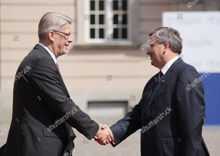 Polish President Bronislaw Komorowski (r) Welcomes President of Republic of Latvia Valdis Zatlers Before the Start of the East and Central European Countries Summit at the Royal Castle in Warsaw Poland 27 May 2011 the Presidents of 20 Central European Countries Opened a Meeting in Warsaw to Discuss Recent Transformations in the Arab World and the Regions Transition Towards Democracy Poland Warsaw