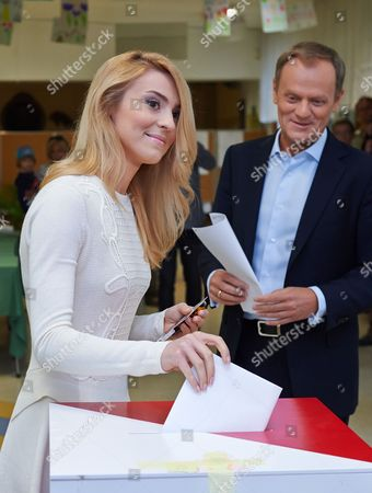 Polish Prime Minister Donald Tusk (r) and His Daughter Katarzyna Tusk Cast Their Ballot For the European Parliament Elections at a Polling Station in Sopot Poland 25 May 2014 the European Elections Will Form a New European Parliament Whose 751 Members Will Help Set Laws in the European Union For Five Years to Come About 400 Million People in the 28-country Bloc Are Eligible to Vote Poland Sopot