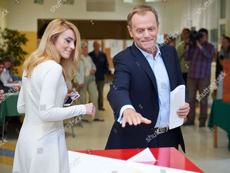 Polish Prime Minister Donald Tusk (r) with His Daughter Katarzyna Tusk Casts His Ballot For the European Parliament Elections at a Polling Station in Sopot Poland 25 May 2014 the European Elections Will Form a New European Parliament Whose 751 Members Will Help Set Laws in the European Union For Five Years to Come About 400 Million People in the 28-country Bloc Are Eligible to Vote Poland Sopot