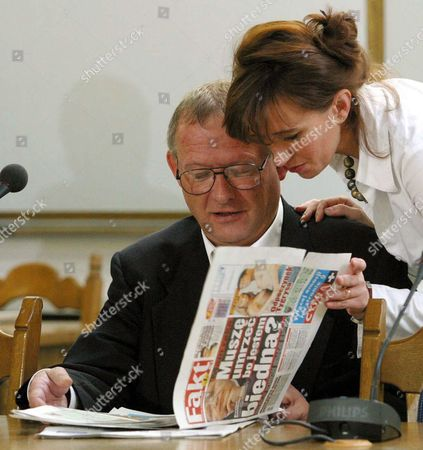 Adam Michnik (l) - Editor of the 'Gazeta Wyborcza' Polish Daily - Looks Through the New Axel Springer Polish Daily 'Fakt' Which Has Its Debut on Wednesday October 22 2003 the Picture was Taken in the Parliamentary Committee (investigating the So-called Rywin Affair) where Michnik Has Testified Today Poland Warsaw