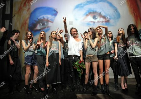 Stock Photo of Polish Designer Robert Kupisz (c) Takes to the Catwalk After His Presentation in Warsaw Poland 17 March 2011 Poland Warsaw