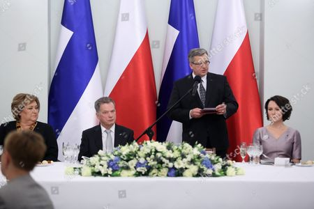 President of Poland Bronislaw Komorowski (2-r) with His Wife Anna Komorowska (l) and Finnish President Sauli Niinisto (2-l) with His Wife Jenni Haukio (r) Attend an Official Dinner at the Presidential Palace in Warsaw Poland 31 March 2015 Finnish President Sauli Niinisto is on His First Official Visit to Poland Poland Warsaw