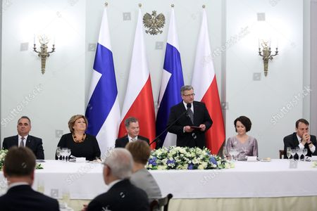 President of Poland Bronislaw Komorowski (3-r) with His Wife Anna Komorowska (2-l) and Finnish President Sauli Niinisto (3-l) with His Wife Jenni Haukio (2-r) and Speaker of the Sejm of Poland Radoslaw Sikorski (r) and the Deputy Speaker of the Sejm Eugeniusz Grzeszczak (l) Attend an Official Dinner at the Presidential Palace in Warsaw Poland 31 March 2015 Finnish President Sauli Niinisto is on His First Official Visit to Poland Poland Warsaw