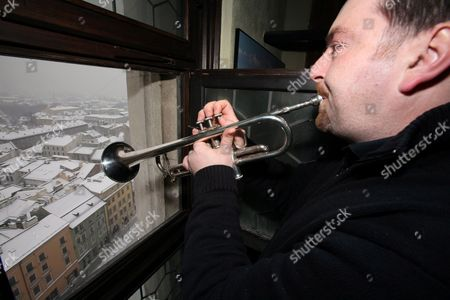 In Honor of Late Polish Poet and Nobel Laureate Wislawa Szymborska Bugler Marian Magiera Plays the Melody Composed to the Szymborska's Poem 'Nothing Twice' From the Tower of St Mary's Church in Krakow Poland 09 February 2012 Poland Krakow