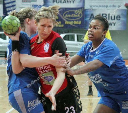 Katrine Fruelund (l) and Alessandra Medeiros (r) of Danish Team Randers Hk A/s Tries to Stop Izabela Puchacz of Polish Team Spr Lublin During Women's Handball Quarterfinal Ehf Cup in Lublin Poland 21 March 2010 Poland Lublin