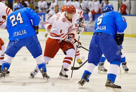 Aron Chmielewski (c) of Poland in Action Against Trevor Johnson (l) and Daniel Sullivan (r) of Italy During the Euro Ice Hockey Challenge Tournament in Olivia Hall in Gdansk Poland 06 February 2014 P Poland Gdansk