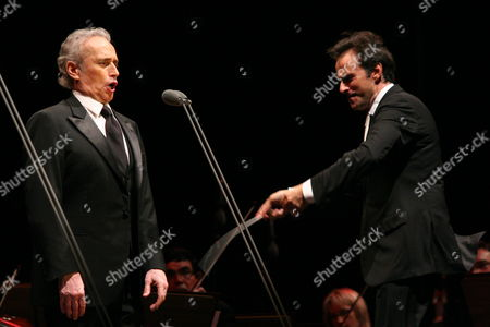Stock Picture of Spanish Tenor Jose Carreras (l) Performs on Stage with Conductor David Gimenez (r) During His Concert in Torun Poland 31 July 2010 Poland Torun