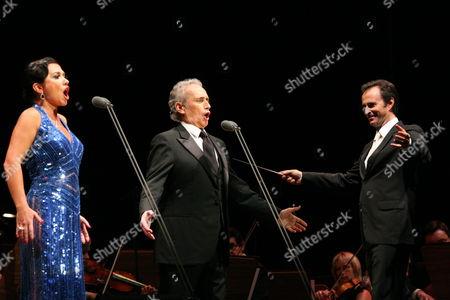 Spanish Tenor Jose Carreras (c) and Ukrainian Soprano Natalia Kovalova (l) Perform on Stage with Conductor David Gimenez (r) During the Concert in Torun Poland 31 July 2010 Poland Torun