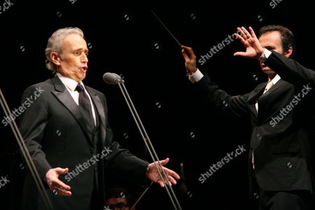 Stock Image of Spanish Tenor Jose Carreras (l) Performs on Stage with Conductor David Gimenez (r) During His Concert in Torun Poland 31 July 2010 Poland Torun