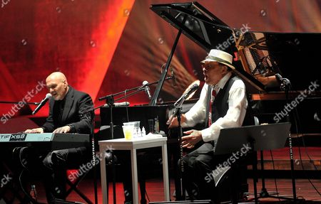 Stock Photo of Us Jazz Singer Al Jarreau (r) Performs on Stage Together with Us Multi-instrumentalist Joe Turano (l) During Their Concert at the Szczecin Philharmonic Hall in Szczecin Poland 01 July 2016 Poland Szczecin
