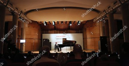 Stock Photo of George Li of the Usa Plays the Piano During Preliminary Audition For 17th International Fryderyk Chopin Piano Competition at the Warsaw Philharmonic Chamber Hall in Warsaw Poland 13 April 2015 the International Chopin Piano Competition Organized by the Fryderyk Chopin Institute is One of the Oldest Music Competitions in the World and Will Be Held From 01 to 23 October Poland Warsaw