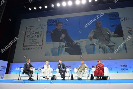 Nobel Peace Prize Laureates the Tibetan Spiritual Leader the Dalai Lama (r) Bangladeshi Mohammad Yunus (2-r) Irish Betty Williams (2-l) Un Under Secretary General Peter Launsky-tieffenthal (l) with Journalist Tomasz Lis (c) at the Sixth Session 'Youth in Solidarity: Be an Advocate For Peace' of the 13th World Summit of Nobel Peace Laureates at the Grand Theater and National Opera House in Warsaw Poland 23 October 2013 the Summit Under the Motto 'Stand in Solidarity For Peace - Time to Act' Runs From 21 to 23 October Poland Warsaw