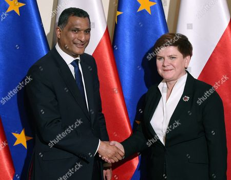 Polish Prime Minister Beata Szydlo (r) and Chairman of the European Conservatives and Reformists Group in the European Parliament Syed Kamall Shake Hands Before a Meeting in Warsaw Poland 22 February 2016 Poland Warsaw