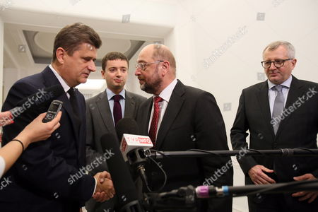 European Parliament President Martin Schulz (2-r) European Parliament Deputy Marek Siwiec (r) and Your Movement (twoj Ruch) Leader Janusz Palikot (l) Speak with Journalists After a Meeting of General Secretaries of Left-wing Formations Members of the Party of European Socialists in Sejm in Warsaw Poland 08 November 2013 Poland Warsaw
