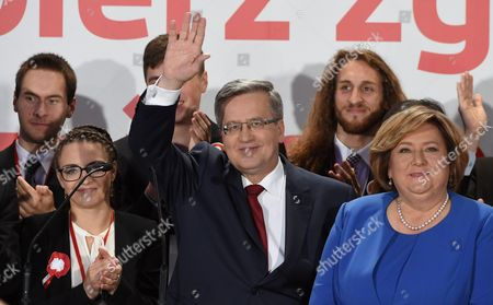 Poland's President and Presidential Candidate Bronislaw Komorowski (c) with His Wife Anna Komorowska (r) During the Presidential Elections Night in Warsaw Poland 24 May 2015 Conservative Challenger Andrzej Duda Looks Set to Be Elected Poland's Next President Ousting Incumbent Bronislaw Komorowski Initial Projections Following 24 May's Run-off Election Show Duda Had Captured 53 Per Cent of the Vote Initial Projections Said Poland Warsaw