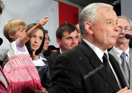 Polish Main Opposition Party Law and Justice (pis) Head and Presidential Candidate Jaroslaw Kaczynski (r) His Niece the Daughter of the Late Polish President Lech Kaczynski Marta Kaczynska-dubieniecka (2-l) Her Daugther Martyna (l) and Her Husband Maciej Dubieniecki (3-l) Seen During Kaczynski's Presidential Elections Night Held in Warsaw Poland on 04 July 2010 the Voting in the Election Runoff Between Kaczynski and the Ruling Party Po's Presidential Candidate Bronislaw Komorowski Has Ended at 2000 Hrs According to First Exit-poll Surveys Komorowski Won Over Kaczynski by a Small Edge Poland Warsaw